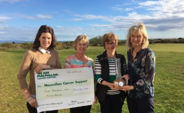 Lyndsay Callander representing McMillan Cancer Support being presented with a cheque for £5,050 from Margaret Carruthers Lady Captain, and the winners of the Rose Trophy Vera Sutton and Mary Corbett who had 37pts.
